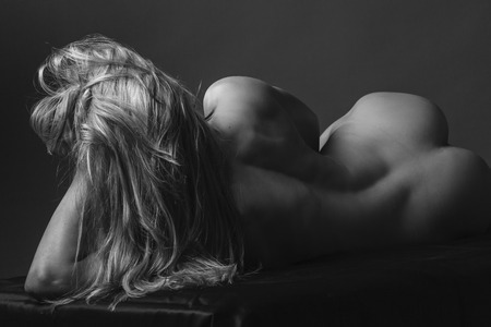 nude blond: Nude young woman in studio