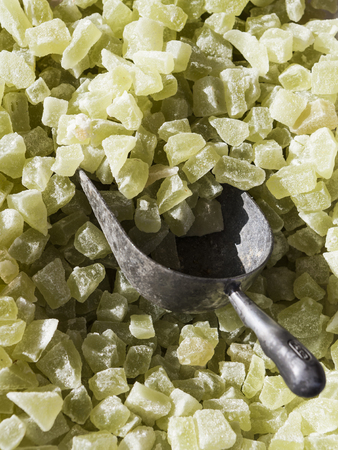 comfit: Light green marmalade candies and a scoop