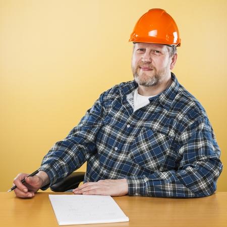 50 54 years: Engineer wearing an orange helmet