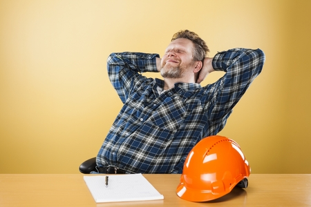 50 54 years: Engineer is relaxing at his office Stock Photo