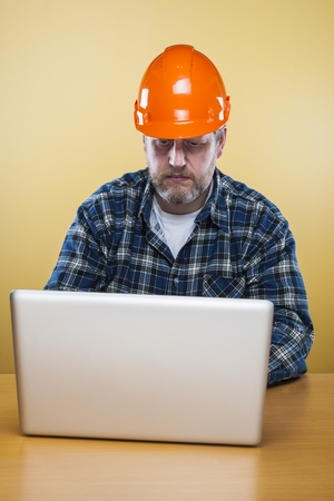 50 54 years: Engineer working with laptop in his office