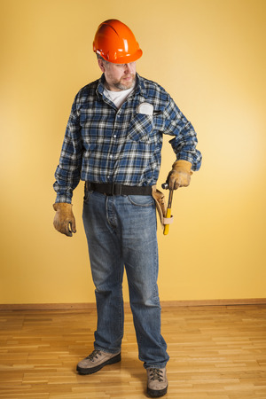 50 54 years: Engineer with a hammer in his hand Stock Photo