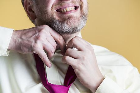 Adult man wearing a necktie