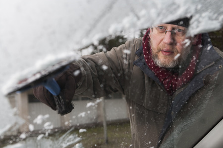 50 54 years: Man working with the ice scraper