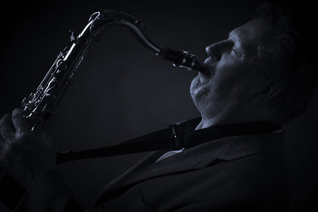 tenor: Adult man playing tenor saxophone Stock Photo