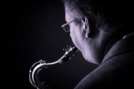 the tenor: Adult man playing tenor saxophone Stock Photo
