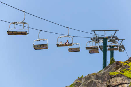 ski lift: Two people in a ski lift in Andorra