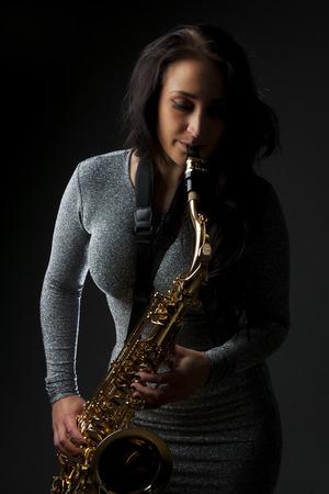 sax: Beautiful Sax Player Stock Photo