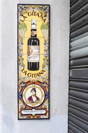 adverts: Wall Advertisement of a local red wine in Seville