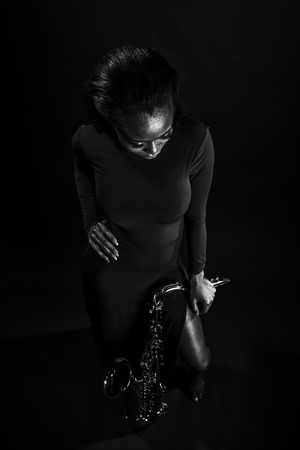 african sax: Beautiful African lady with her saxophone Stock Photo