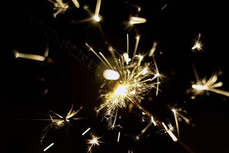Fireworks of the sparkling sparks of a sparkler
