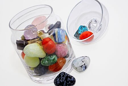 A collection of gemstones, semi-precious stones and minerals displayed in a glass Stock Photo