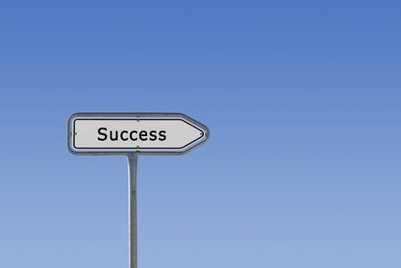 An arrow sign on a signpost reading Success and pointing to the right, isolated on a blue sky gradient.