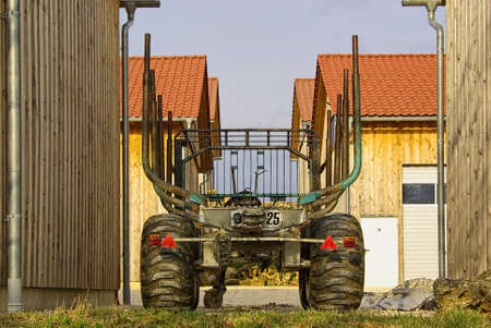 A trailer being used for transporting tree trunks and the like. Stock Photo