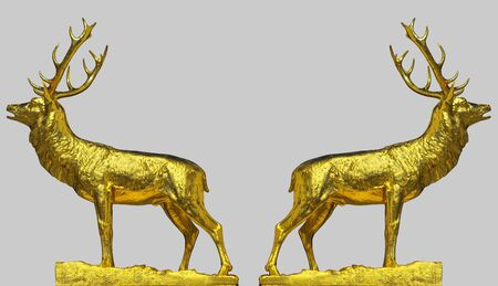 A pair of golden statues of the red deer doing the rutting call, isolated on silver background