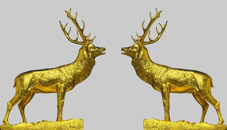 rutting: A pair of golden statues of the red deer doing the rutting call, isolated on silver background