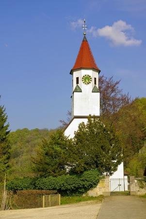 Sommige kleine kerk van een klein Duits dorpje in het voorjaar Stockfoto