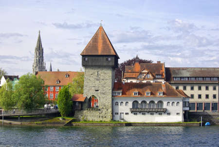 View of the socalled Rheintorturm tower from the 13th15th century, in the background the spire of the Minster of Our Lady, Constance, Lake Constance, Germany, Europe. photo