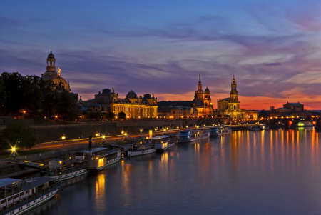 View of the baroque historic waterfront of the city of Dresden, Germany, after sundown with the Blue Hour setting in  Stock Photo