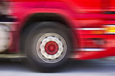 A fast moving truck passes by with motion blur  photo