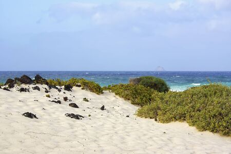 Beach of white sands holds a beautiful view of the Atlantic ocean, near Orzola, North of Lanzarote, Spain  Stock Photo