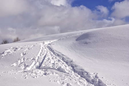 A wintry hills, lost in deep snow Stock Photo