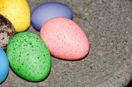 Colourful Easter eggs in a bowl.