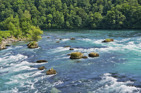 River landscape with rapids upstream the Rhine Falls, Schaffhausen, Switzerland. Stock Photo