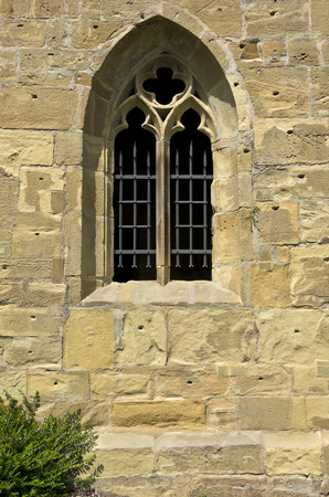 Gothic window with tracery in a wall opening.