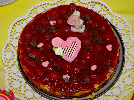 Strawberry birthday cake for a childs 4th birthday party.