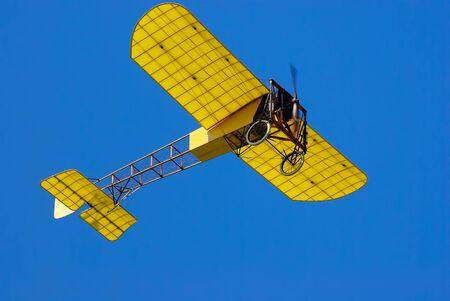 Overflight of a vintage aircraft model Bleriot XI.