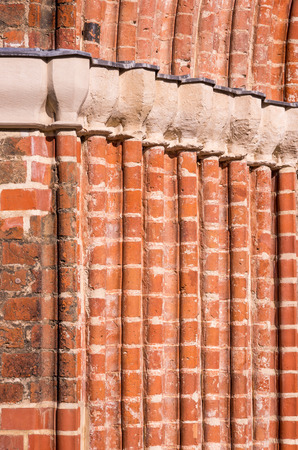 volts: Archi Volts of the entrance of a medieval brick Gothic church. Stock Photo