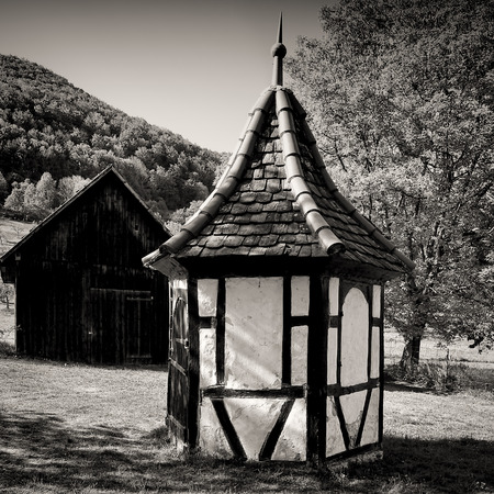 Round hut and barn in the rural environment of an orchard, here at Bad Urach, Swabian Alb, Germany.