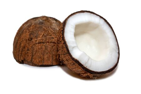 Two halves of a coconut fruit isolated on white.