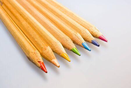 Seven colored pencils on a pad. Banco de Imagens