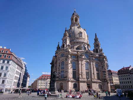 Dresden, Germany - August 7, 2017: View over Neumarkt Square and tourists in front of Frauenkirche Church in Dresden, Saxony, Germany.