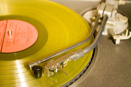 recordplayer with yellow lp records (33 13 rpm) Stock Photo