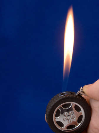 pyromania: lighter in the form of wheel on blue background