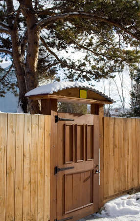 section of wooden fence with gate
