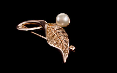 golden ear-ring as a leaf with pearl