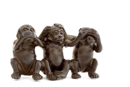 antics: set of 3 ebonite monkeys Stock Photo