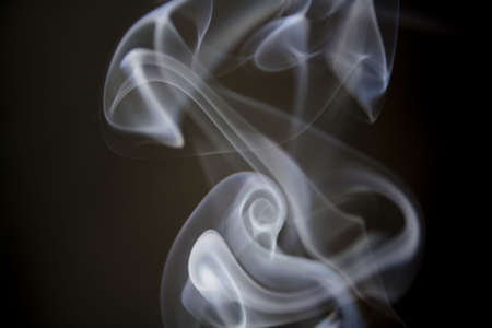 puff of aroma smoke on a dark background photo