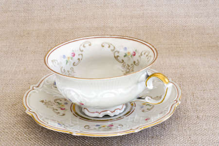 Antique floral cup on the sackcloth