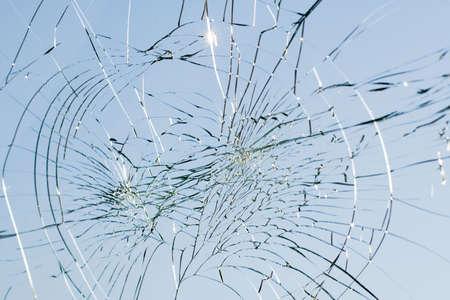 damaged vehicles: web of splits on the triplex windscreen