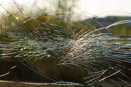 web of splits on the triplex windscreen