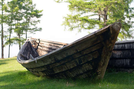 old wooden fishing boat on the Baikal lakeside Stock Photo