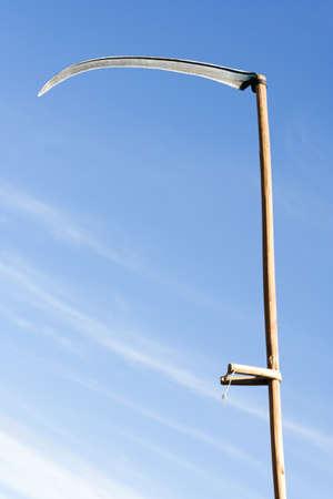 sharpen scythe with blade as a razor edge Stock Photo