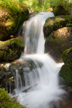 mountain stream running over mossy rocks in siberia (foothills of Sayan's mountain range) Stock Photo - 1677827