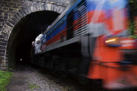 baikal: Locomotive driving out from tunnel.  Old, long (0.78 km) and straight railroad tunnel of the Circum-Baikal Road, the historical part of Trans-Siberian railway, near Lake Baikal, Russia. In total, part of the railroad from source of Angara river to the sou