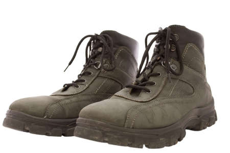travelled: used pair of working boots isolated on white